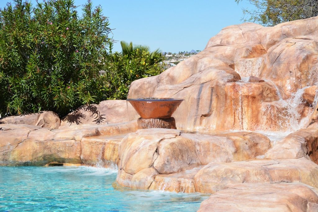 Pool landscaping design with rocks